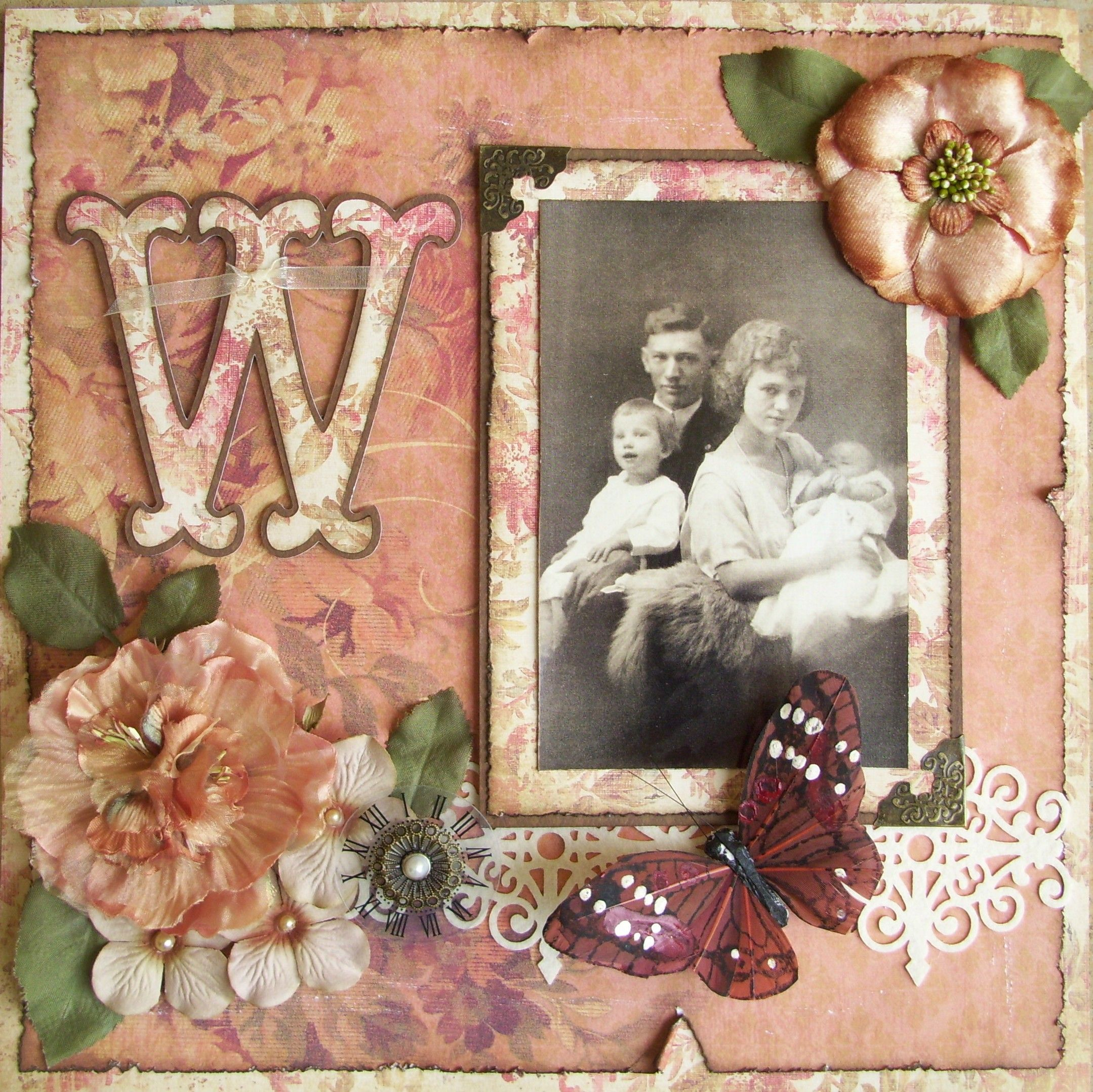 The Welch Family ~ An elegant heritage page with the perfect balance of 'vintage bling' and simplicity. Love how the embellishment paper used for the frame, monogram and distressed edging subtly contrasts to the background paper.