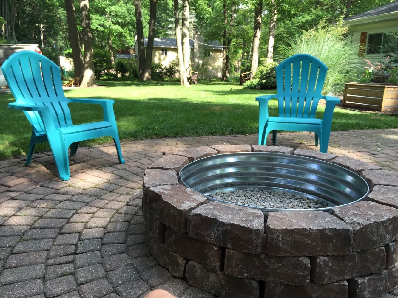 Backyard fire pit. Lowes paver bricks with Tractor Supply fire ring.