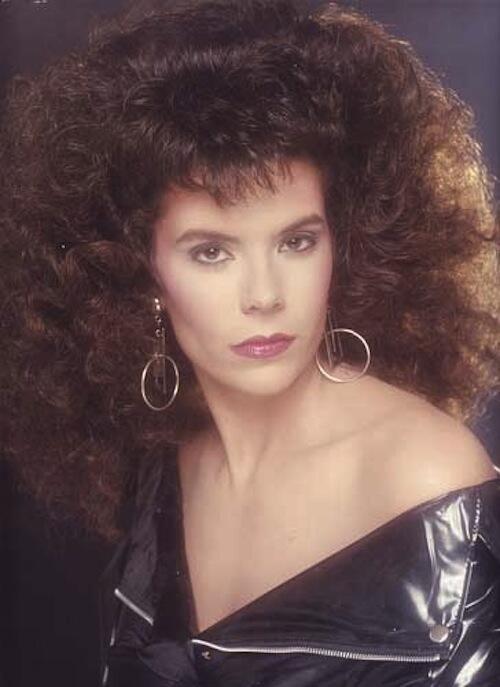 80s big hair. Vinyl jacket.