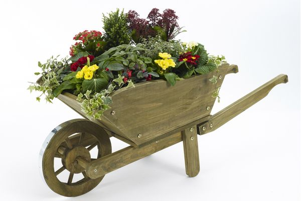 The Joy Of Making A Patio Flower Container Garden Wheelbarrow Planter Patio Flowers Container Gardening Flowers