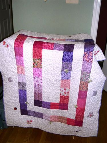 Bloomer's Baby Quilt - Made for my daughter. Applique bits are from her baby clothes and other nursery items.