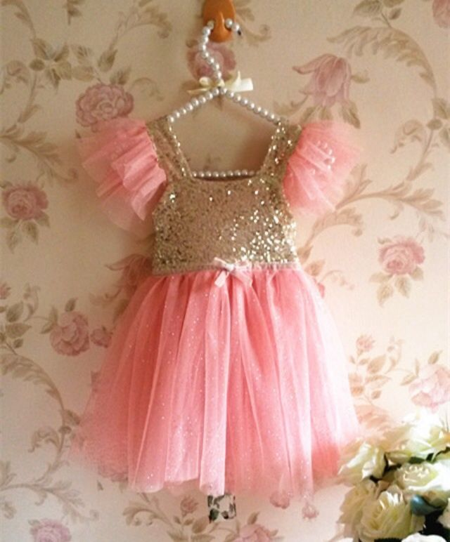 Sale! $25 Regular $30 Beautiful pink and gold sequin dress made for a princess. This sleeveless, knee-length dress will make your little girls stand out and look beautiful! *NOTE: The dress color is darker on photo. Dress fits small, buy larger size if possible. *limited quantity availab...
