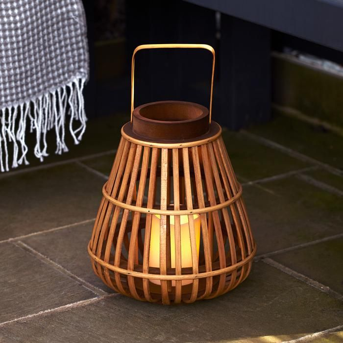 Lanterns Bamboo Battery Lantern Our 30cm bamboo lantern is perfect for a warm glow within your home or out in your garden in summer months The ivory candle stands at 10cm...