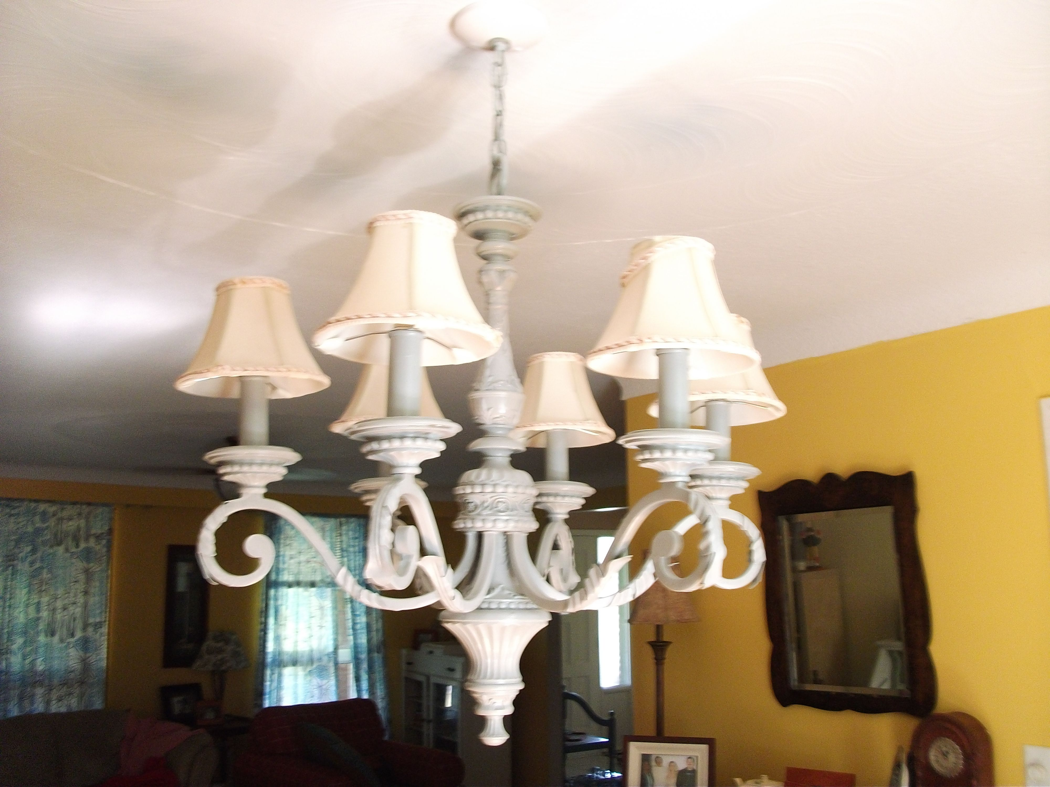 My chandelair I found and bought for a mere 10 bucks..painted it and ...