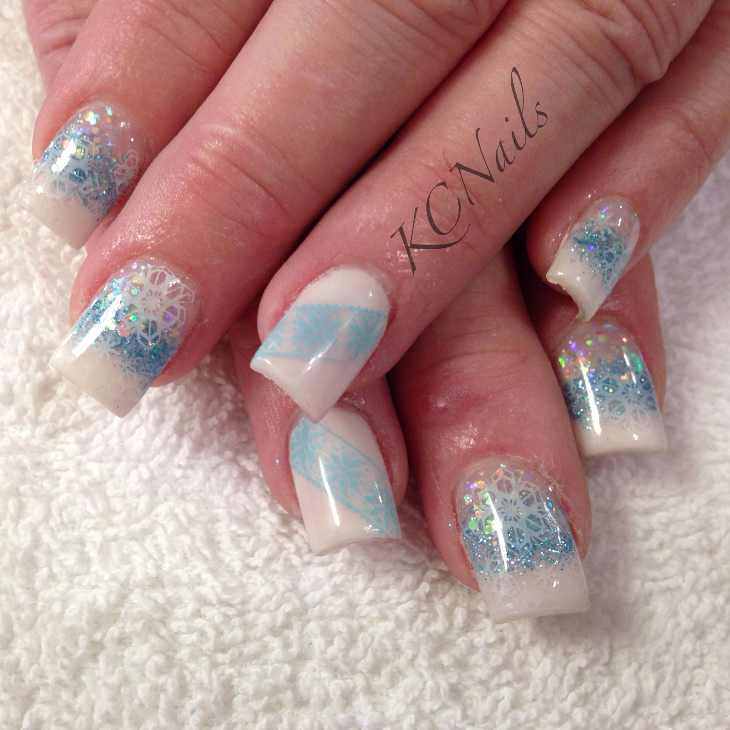 winter wonderland white and blue acrylic nail fade stamped white snowflakes and christmas