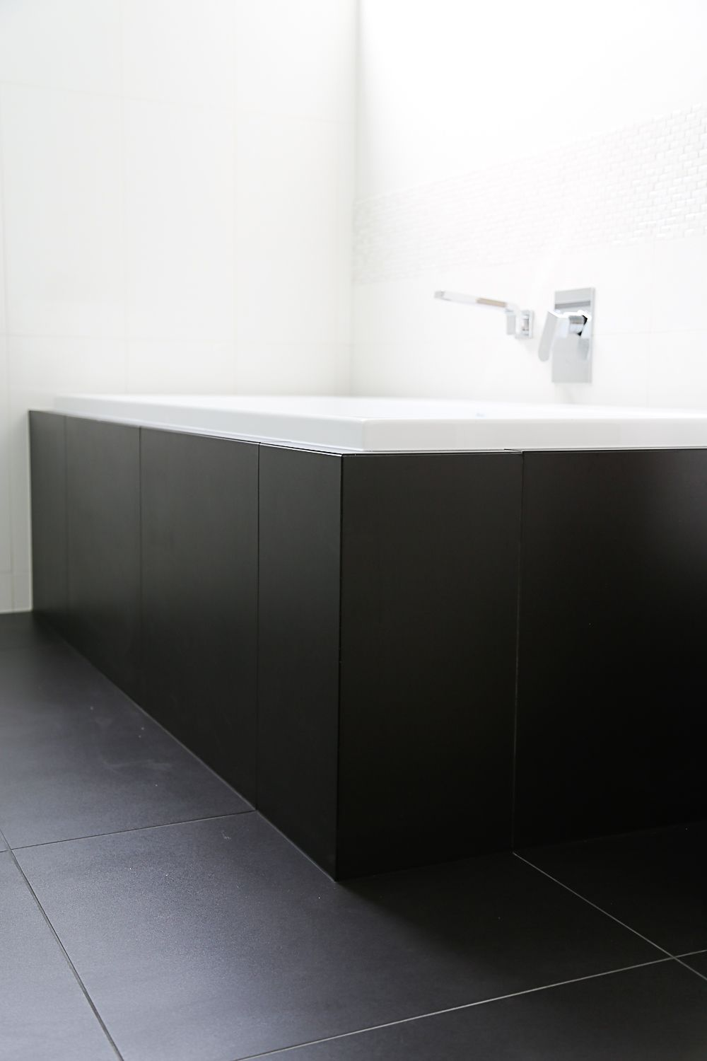 Black Floor Tiles And White Wall Tiles With Mosaic Feature Tiles