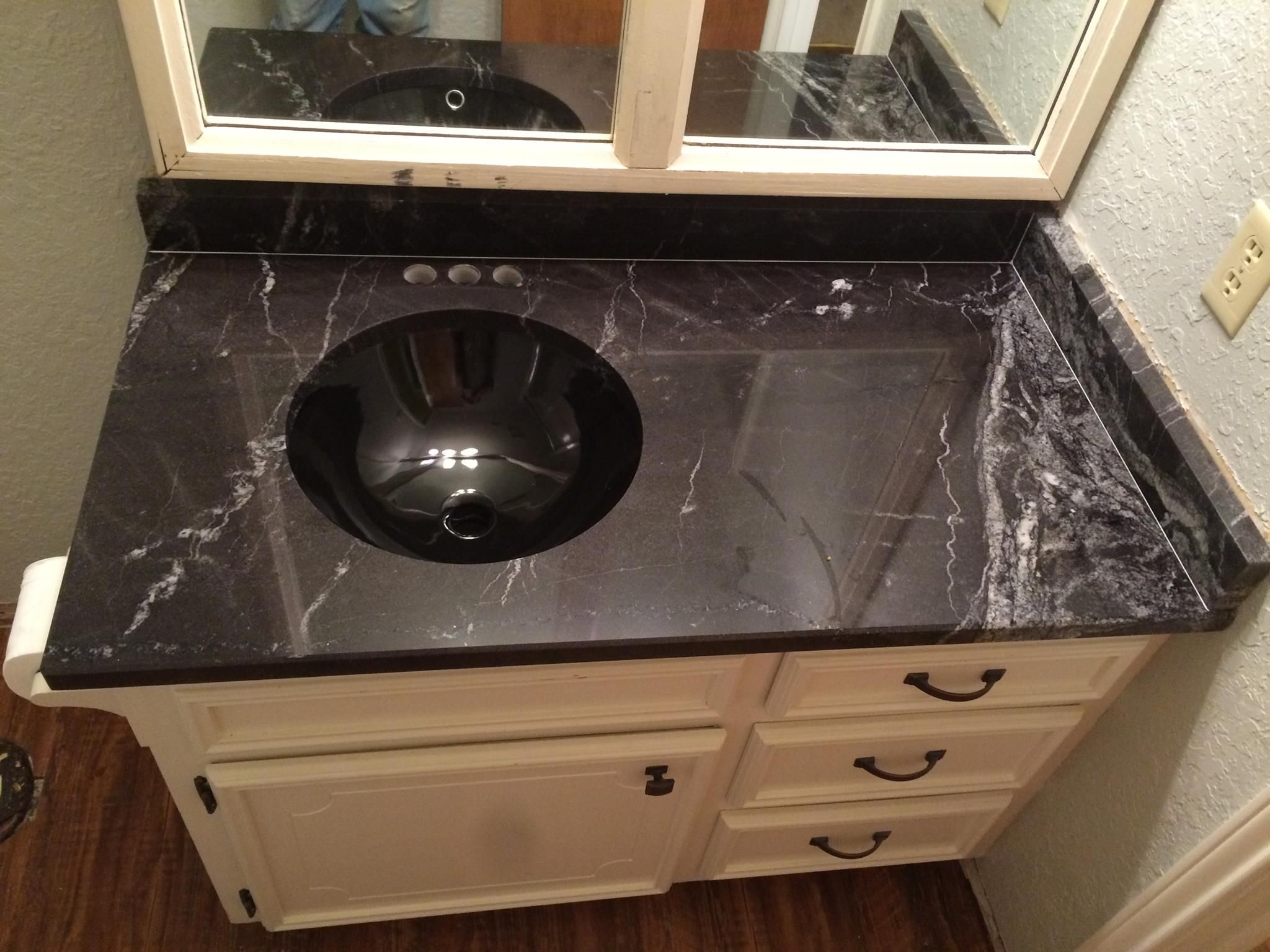 Black Sink And Countertop In Bathroom Arabian Nights Granite