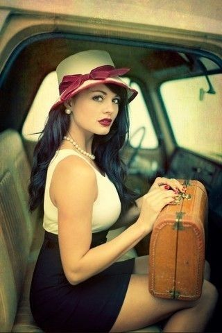 Red Bow Hatted Blk/White Dressed Suitcase carrying Woman