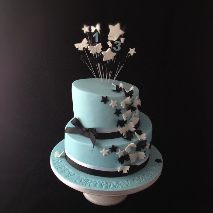 Topsy turvy 13th birthday cake in pale blue with black and white
