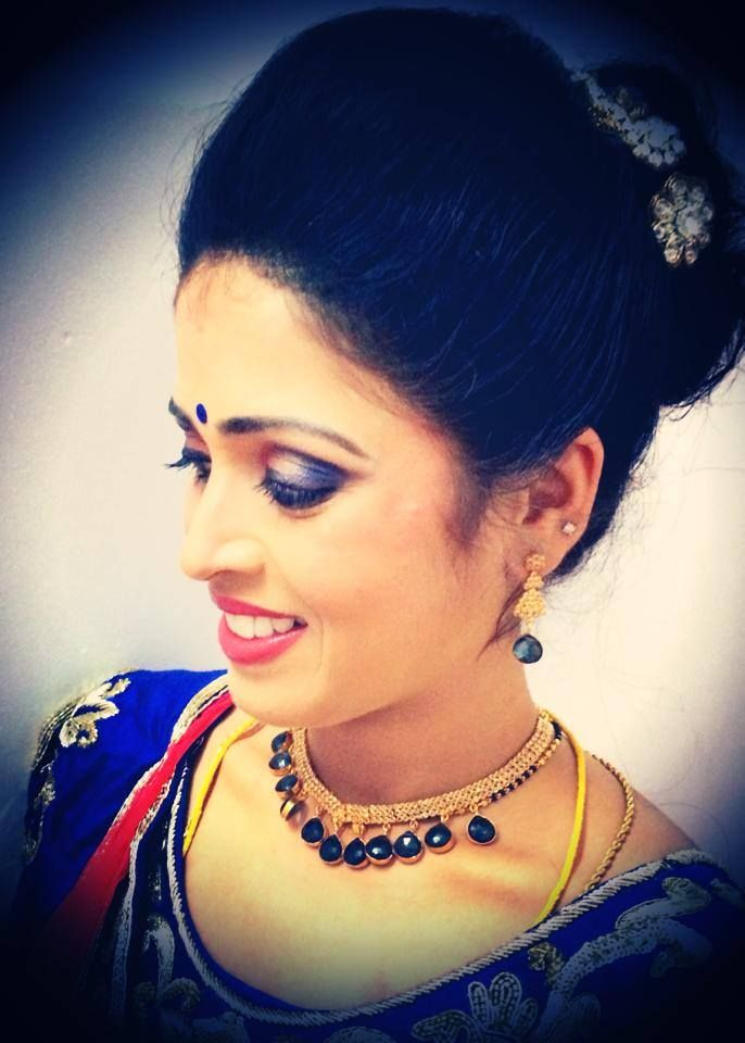 Indian Brides Reception Hairstyle Created By Swank Studio - Bun hairstyle for reception
