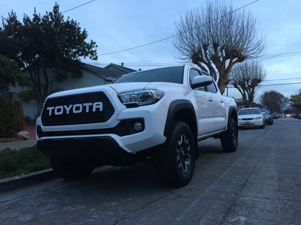 Black mesh white toyota letters 2016 grill