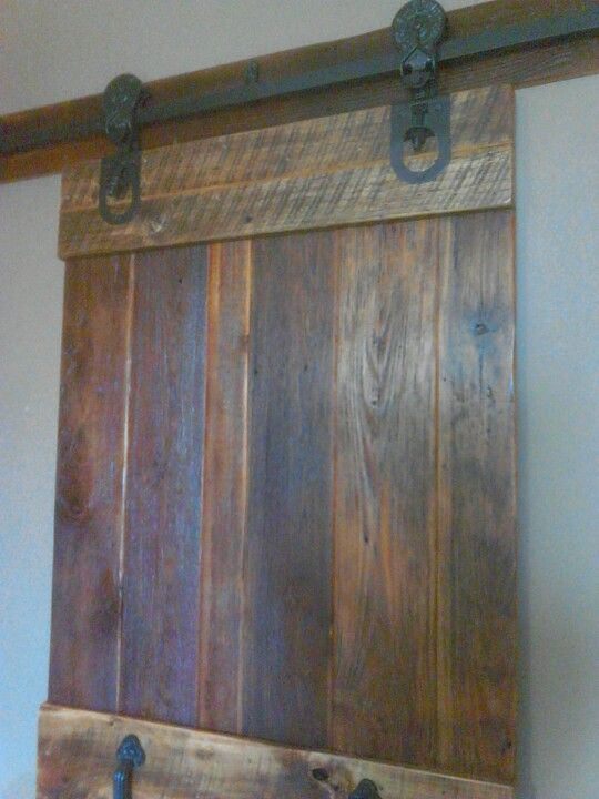 Antique barn door rollers have date of May 28, 1900 on them. We custom made  the door from select old growth heart pine and rough sawn oak. - Antique Barn Door Rollers Have Date Of May 28, 1900 On Them. We