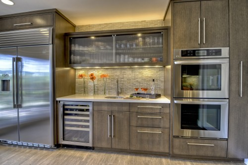 Love Clean Contemporary White Oak Slab Cabinets With A White Chroma Crystal White Countertop Cab Contemporary Kitchen Glass Kitchen Cabinets Staining Cabinets