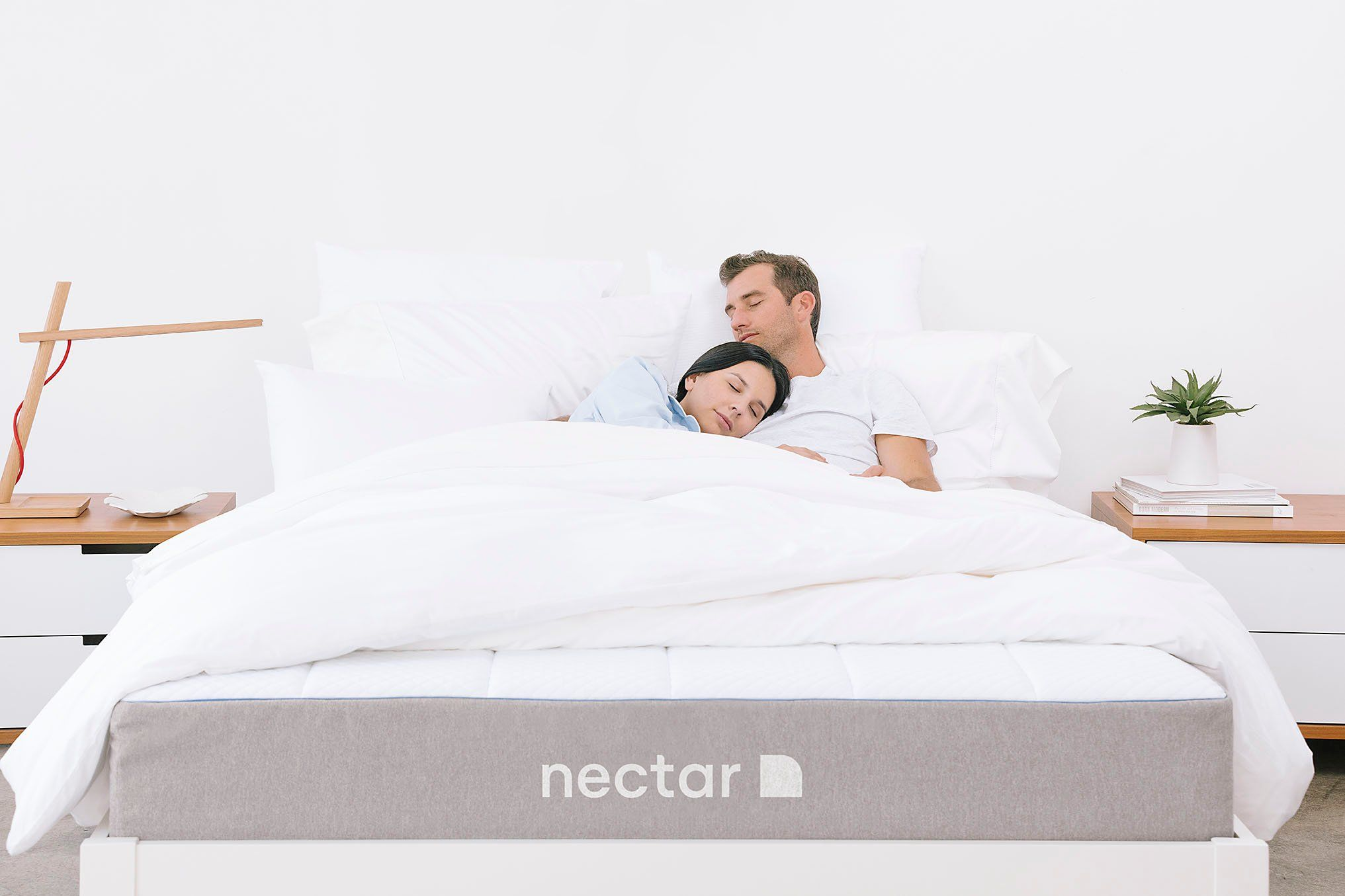 Couple sleeping white bed Nectar Mattress the most