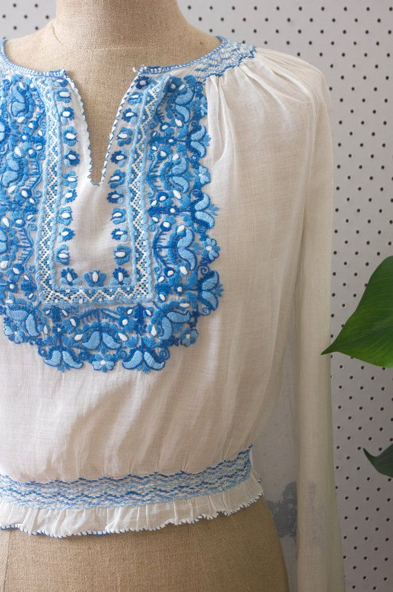 vintage silk and cotton blend hungarian blouse. beautifully light and sheer, this stunning blouse features incredible blue embroidered detailing
