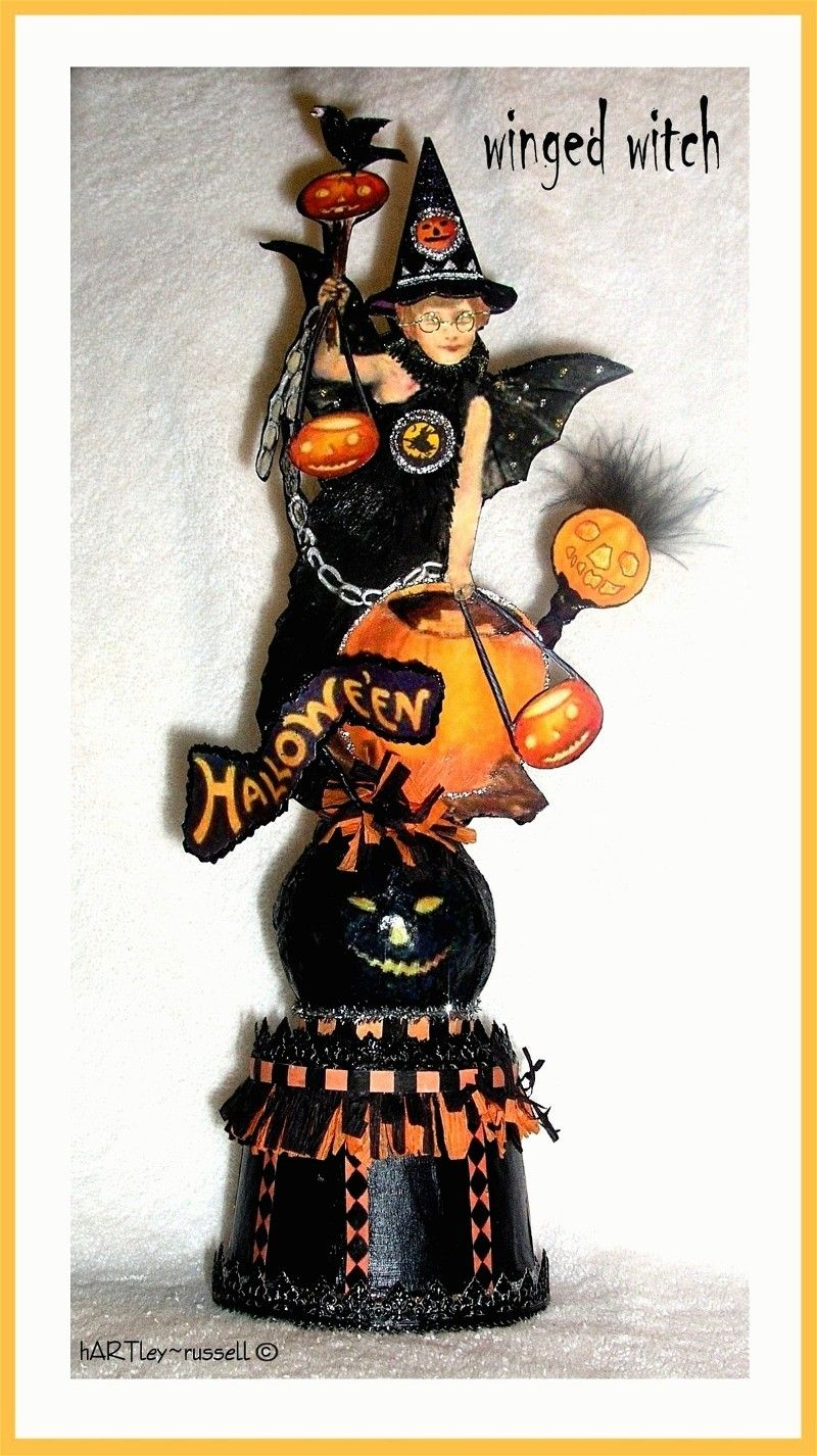 Halloween mixed media tabletop winged witch sculpture.