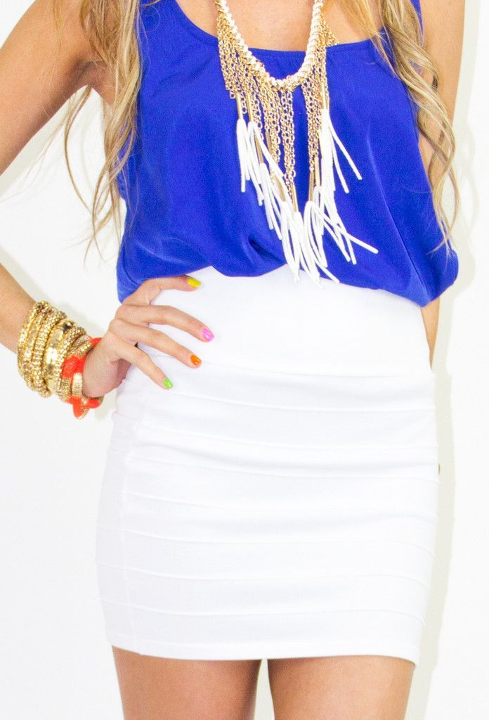 Deep blue tank w/ pure white bandage skirt, tied in with a low bib necklace.