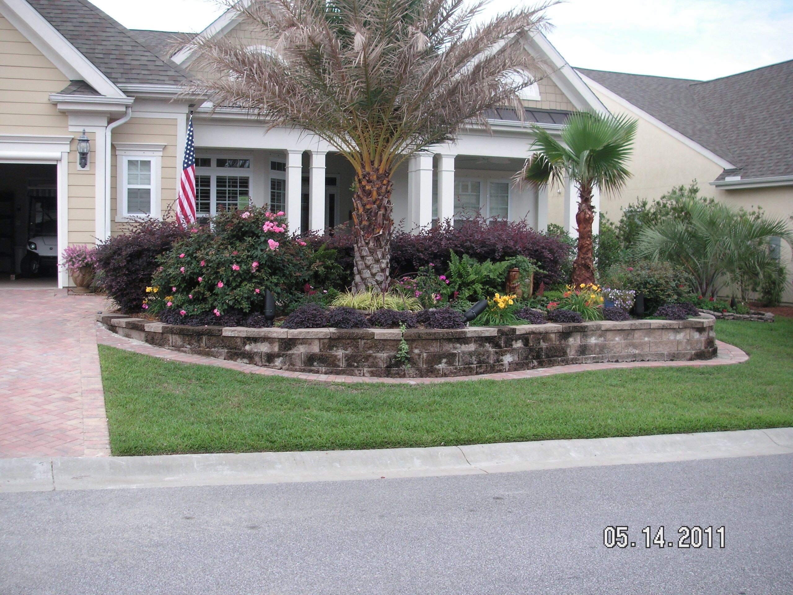 Sun City Hilton Head Is Located In Bluffton Sc Garden Features Front Yard Design Landscape