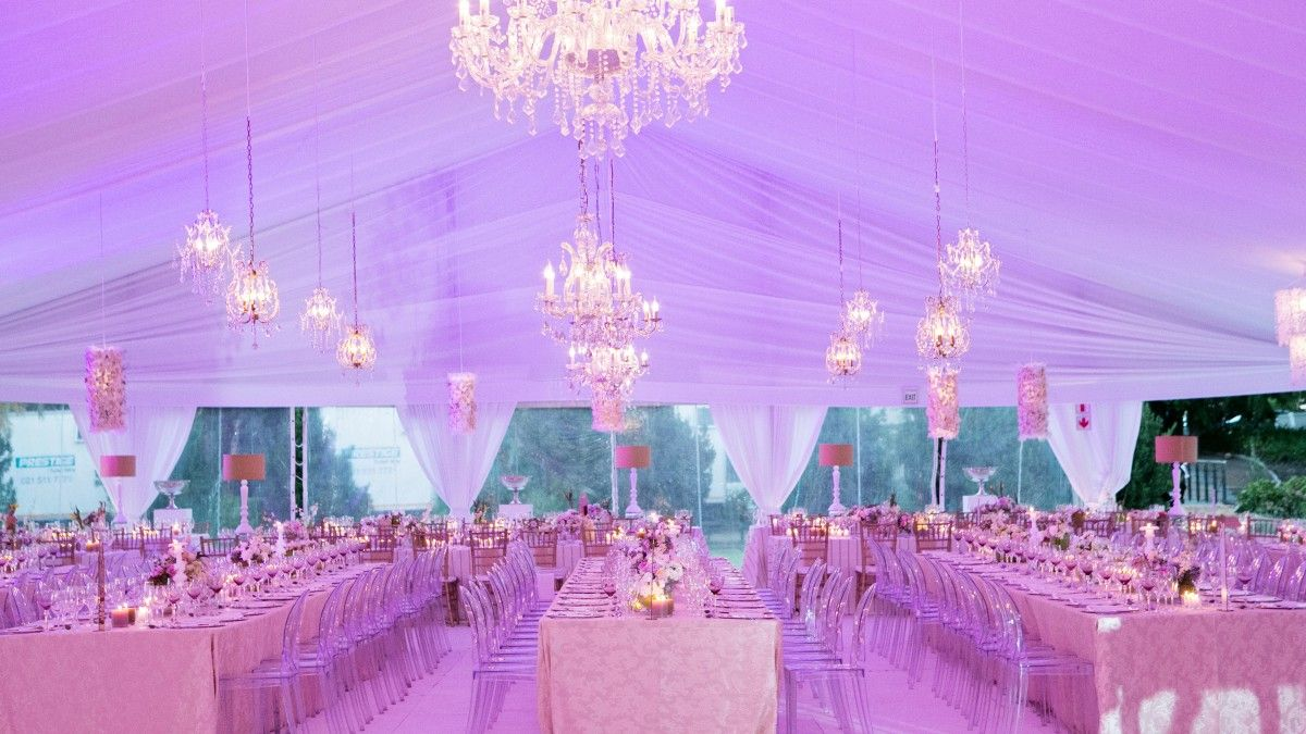 Chandeliers make this tent over the top and glam coronado island glamorous tent wedding reception and decor junglespirit Gallery