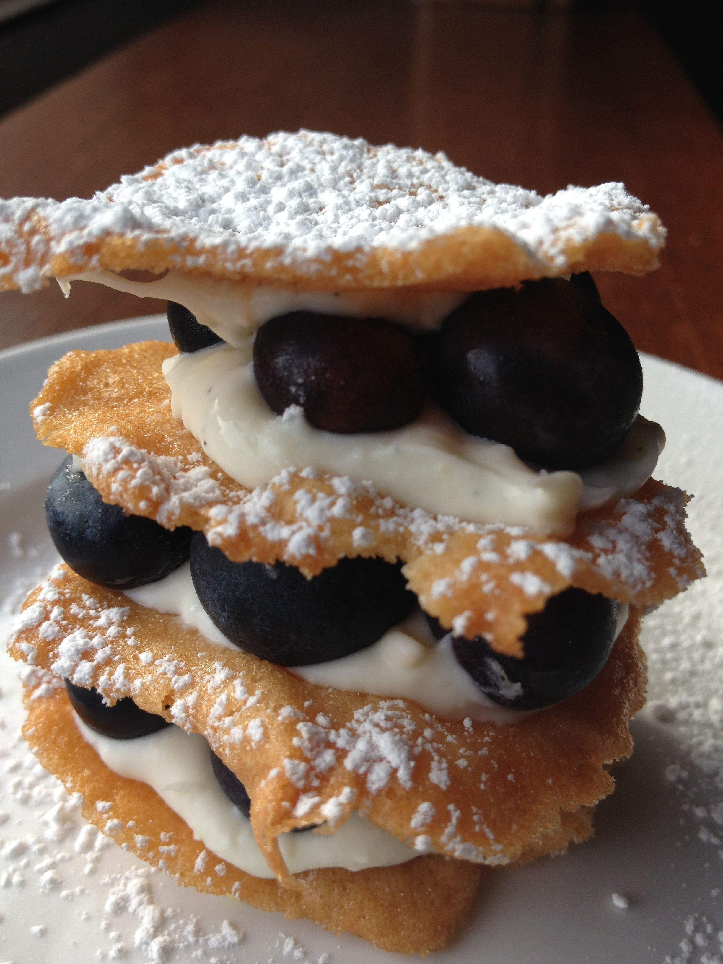 Tuile Cookies with house-made mascarpone cheese and fresh blueberries.