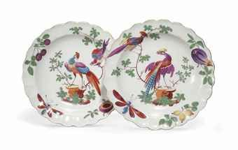 A PAIR OF WORCESTER SCALLOPED DISHES CIRCA 1770 Decorated in the atelier of James Giles with exotic birds perched on rockwork and branches, the borders with fruit and insects within a gilt line rim 7¼ in. (18.4 cm.) wide (2)