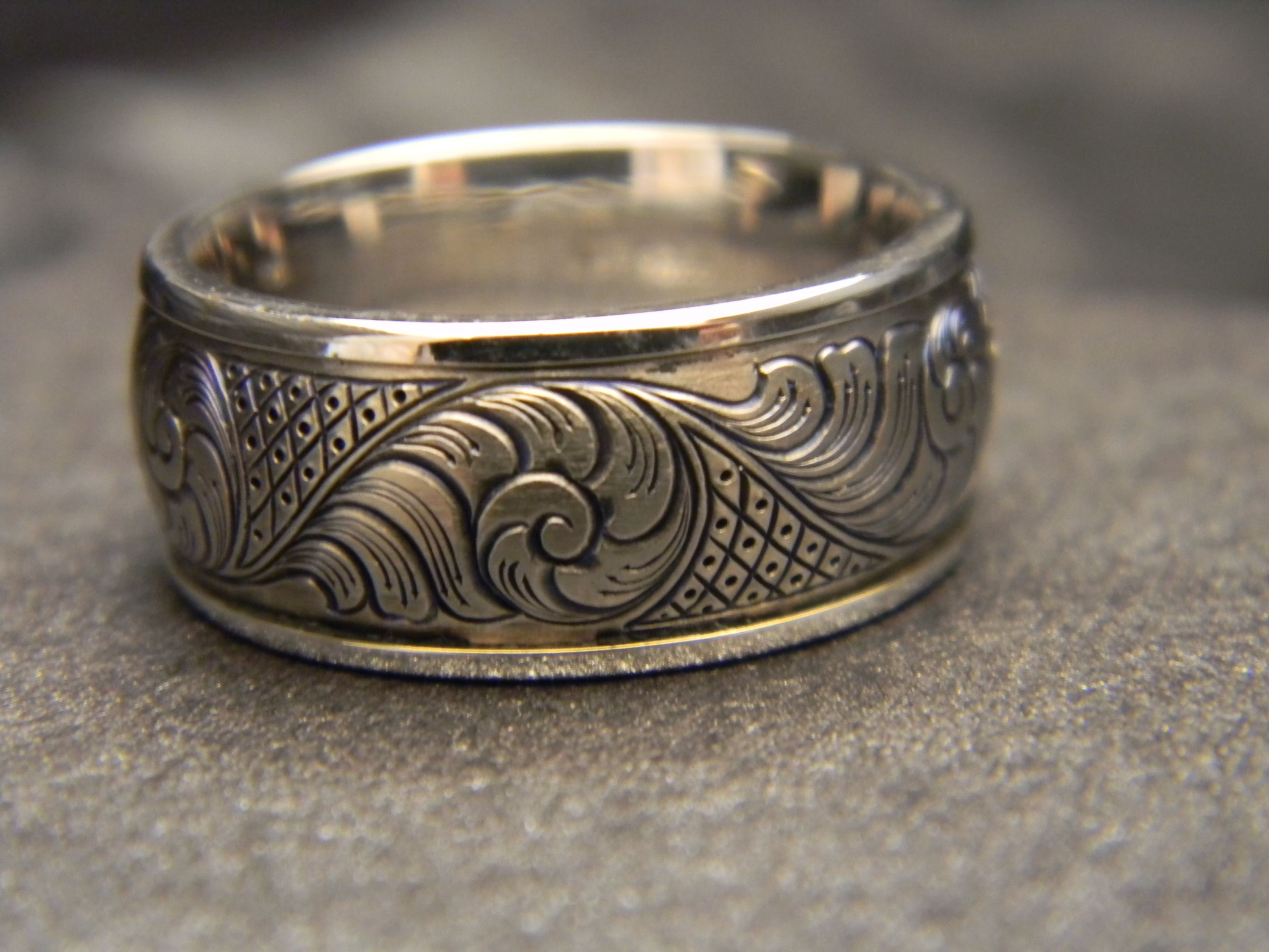 10mm wide titanium hand engraved ring with 14k white gold for Engraving on mens wedding rings