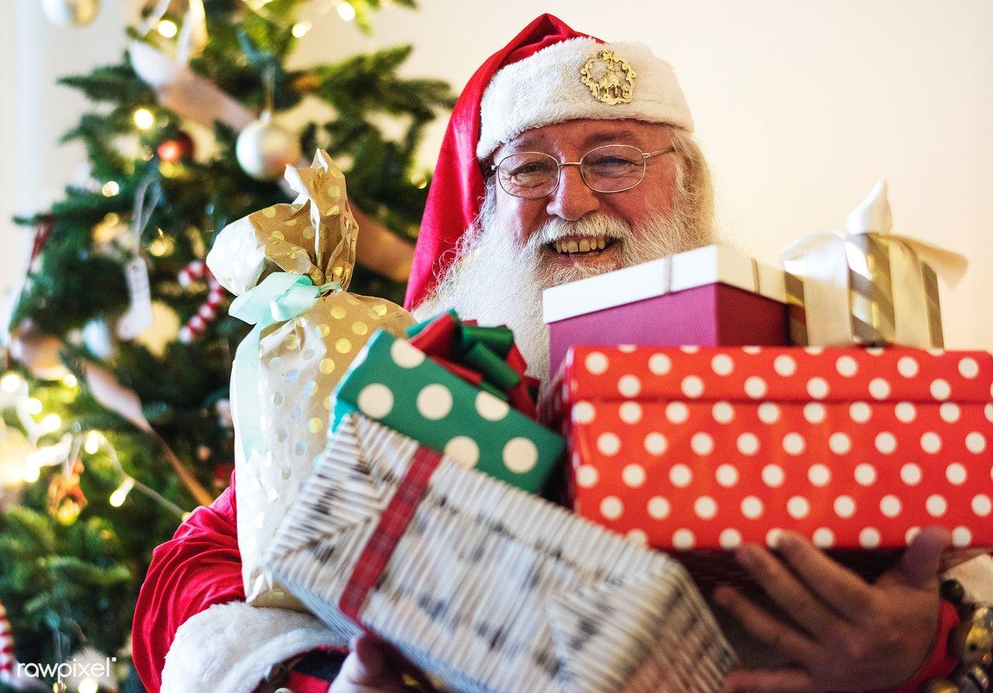 Download Premium Image Of Santa Claus Carrying A Lot Of Christmas Presents Santa Claus Images Merry Christmas Gifts Christmas Present Vector