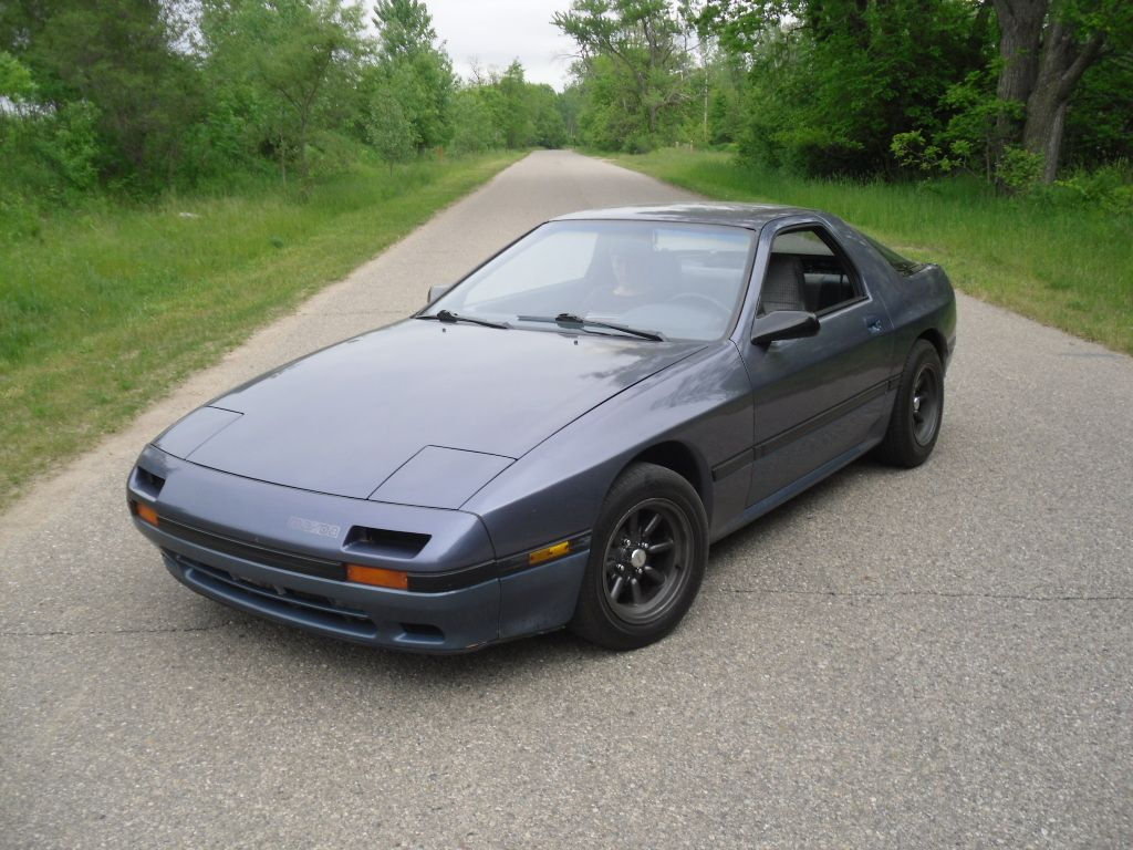 1986 Mazda RX-7. I learned to drive a stick at age 15 in a ...