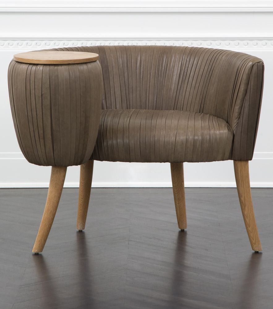 Kelly wearstler leather souffle cocktail chair exquisitely detailed chair with a small attached tabletop