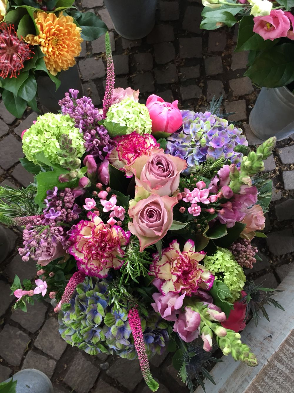 Large purple bouquet using roses, carnations, Veronica