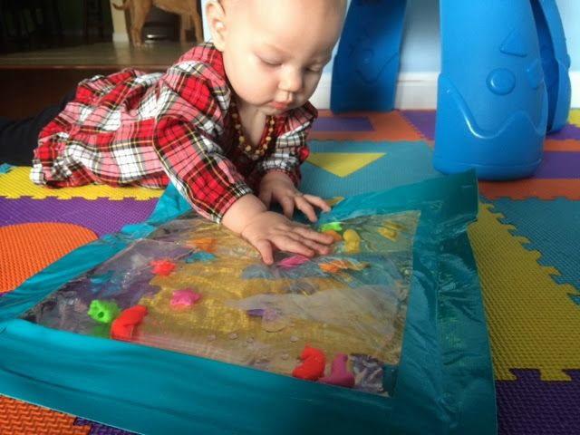 I Recently Went To Someone S House For A Baby Wearing Pet The Carriers Meeting And They Had This Super Fun Water Mat For He Diy Water Water Mat Baby Toys Diy
