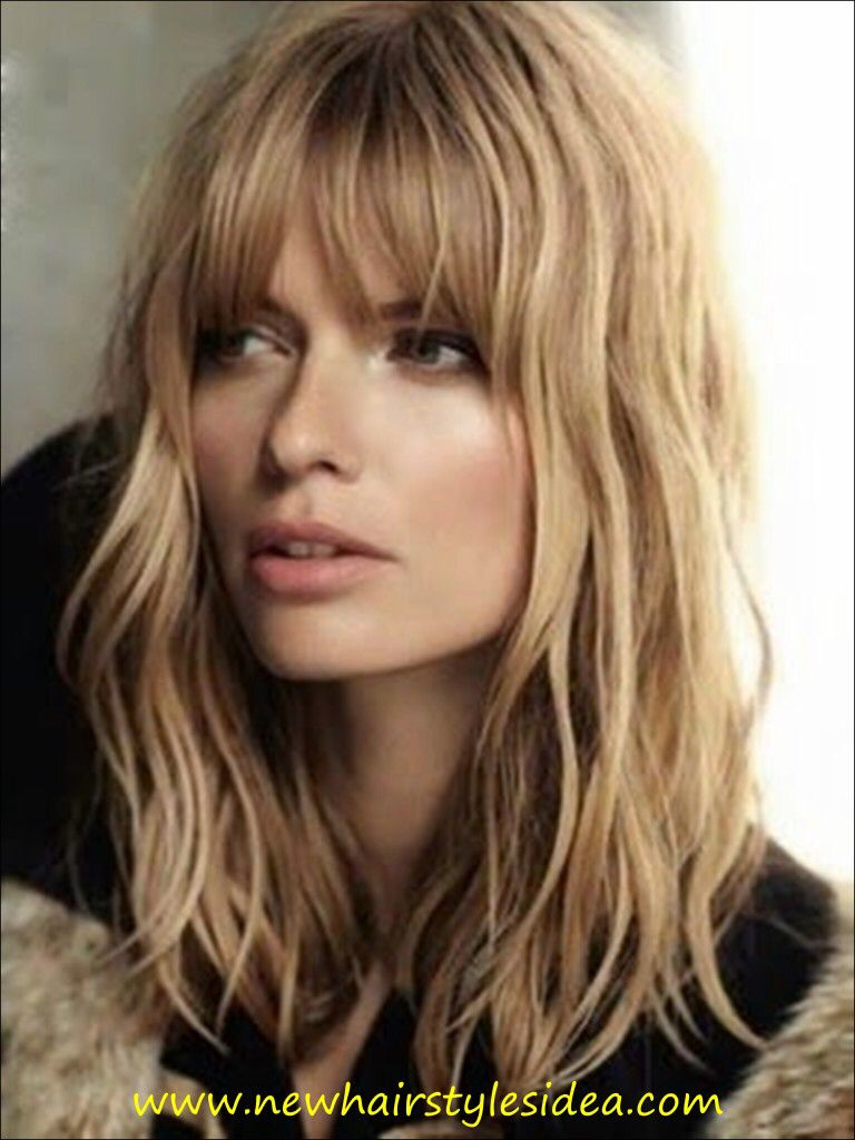 A good example of Bangs. Love her hair length and curl. Very natural and feminine.