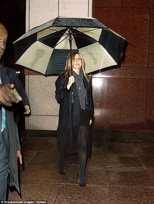 Jennifer Aniston stays dry beneath enormous umbrella as she steps out in NYC #largeumbrella