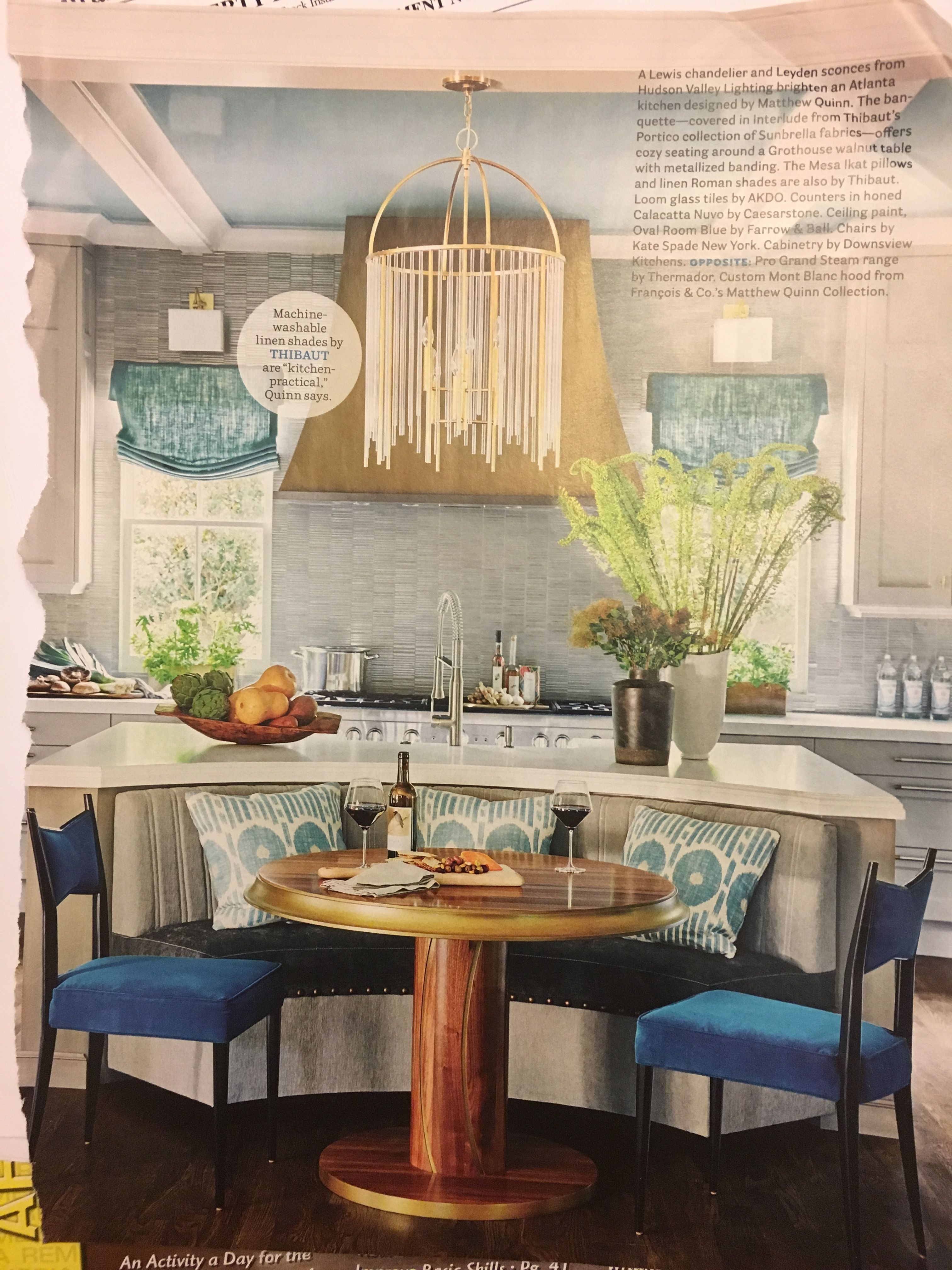 Banquette and little table backed up to island Kitchen