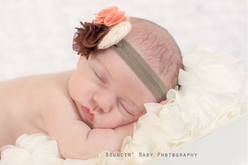 Beautiful baby girl bouncin baby photography specializes in newborn photography in hospital studio or