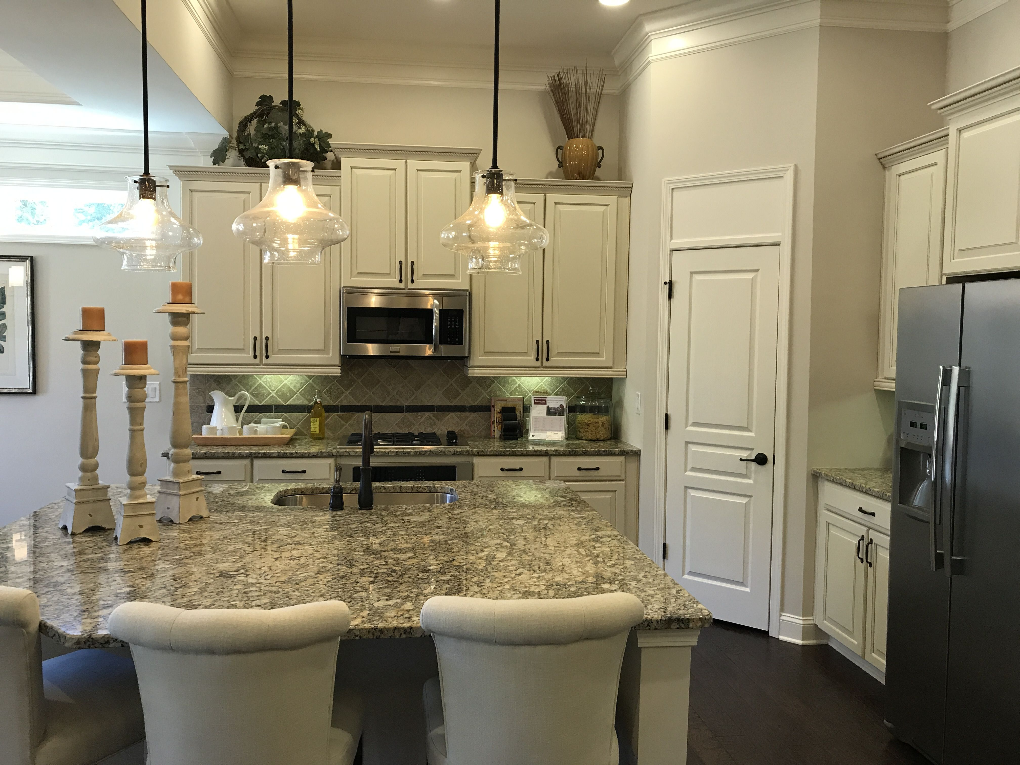 White kitchen with kitchen island and walk in pantry! # ...