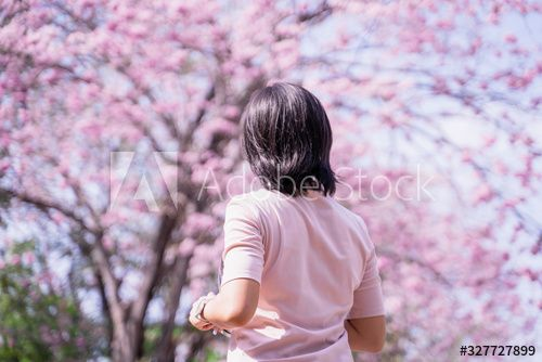Happy asian woman tourist in spring blossom park walking and take a photo leisure activity in holiday trip , #ad, #tourist, #spring, #blossom, #Happy, #asian #Ad