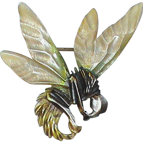 Offered for sale is this delightful Art Nouveau carved horn bumble bee brooch. It is not signed but is of high quality with some coloring to the body