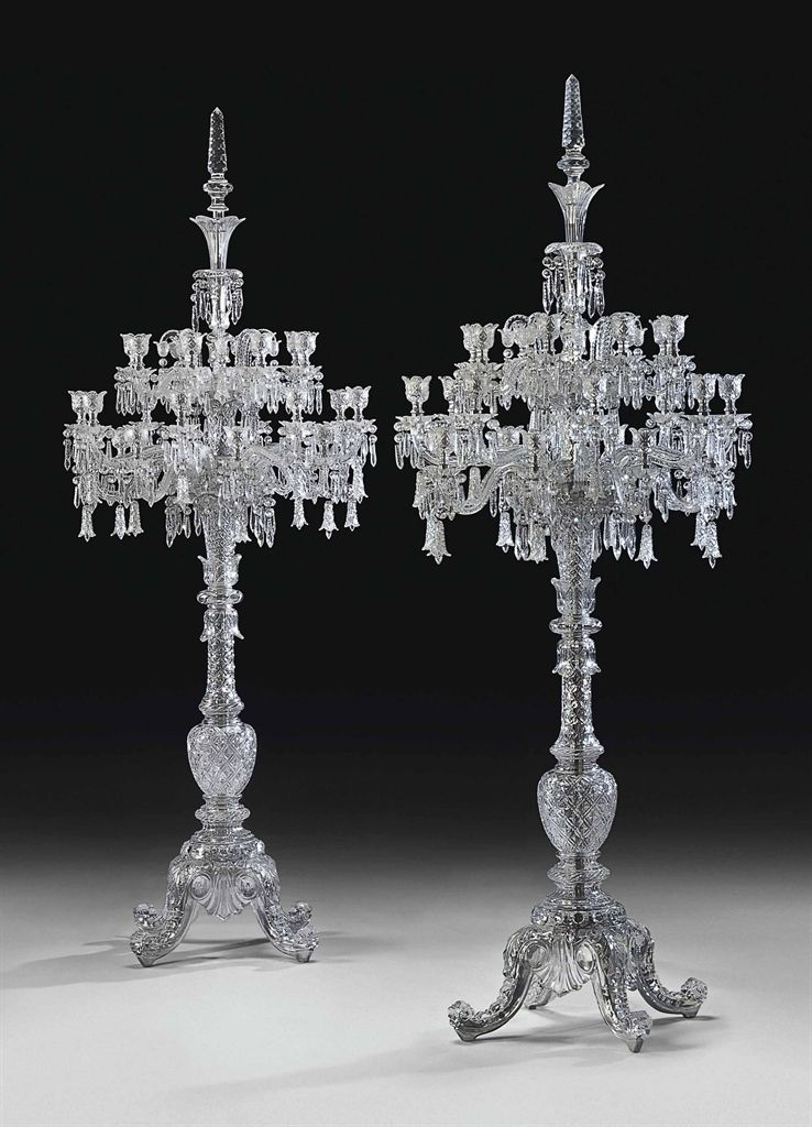 A large pair of french cut crystal twenty four light torcheres by cristalleries de baccarat paris 20th century