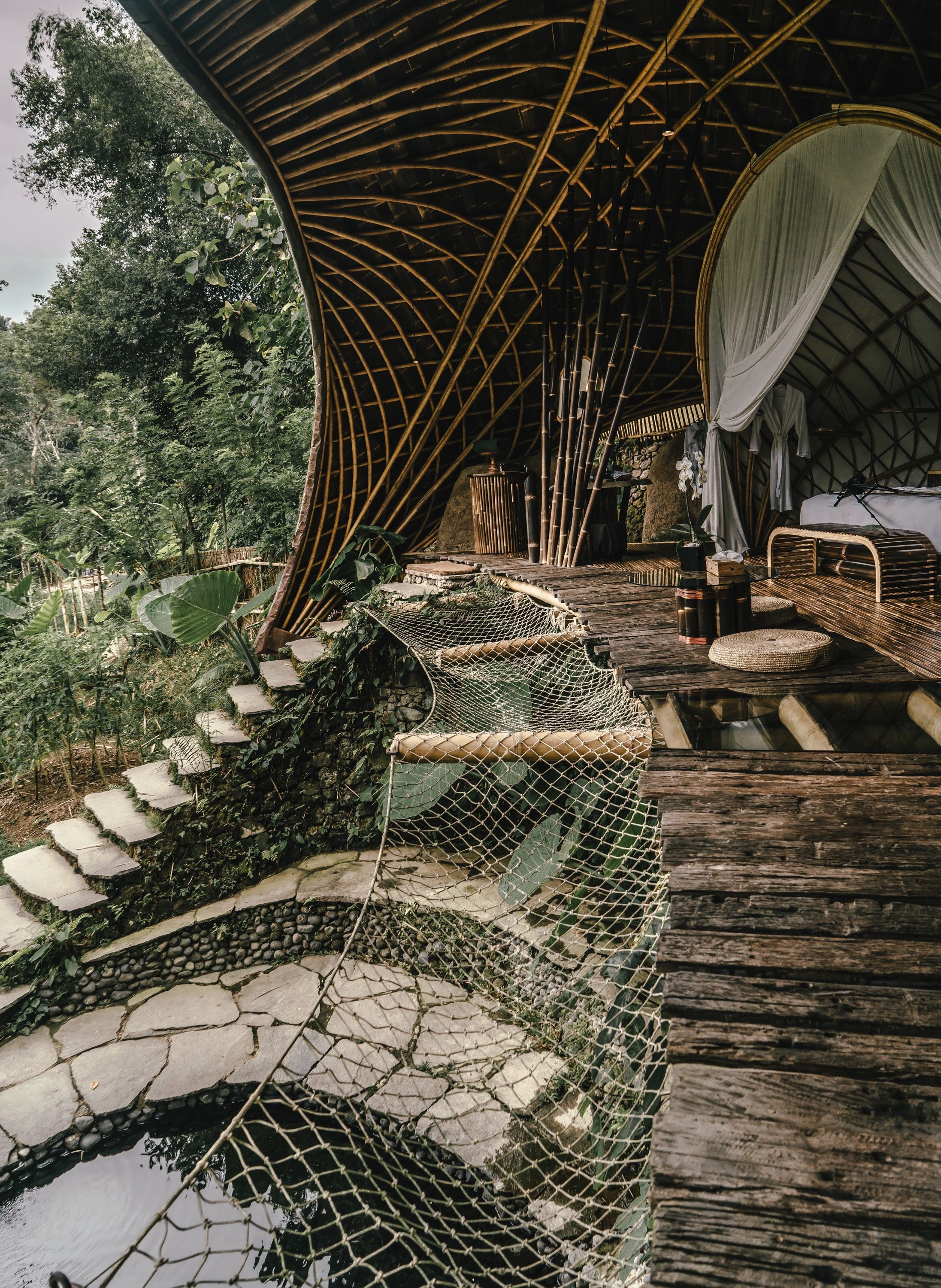 Staying In One Of The Most Beautiful Treehouse Hotels In The World Bambu Indah Bali Treehouse Hotel Tree House Beautiful Hotels