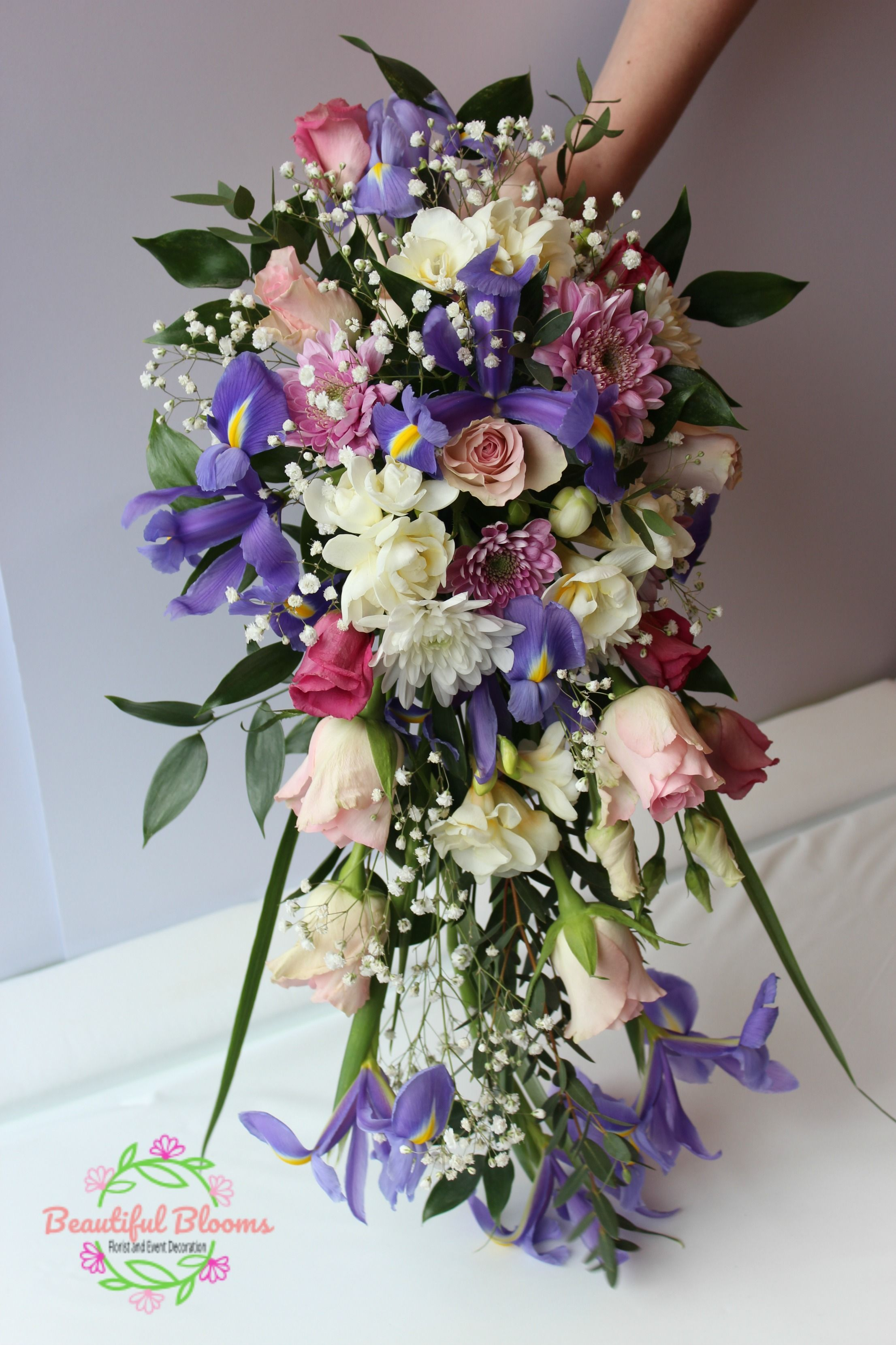 Beautiful cascade bridal bouquet featuring roses and iris in dusky beautiful blooms is a wedding and event florist in swindon creating beautiful wedding flowers and sympathetic funeral flowers izmirmasajfo