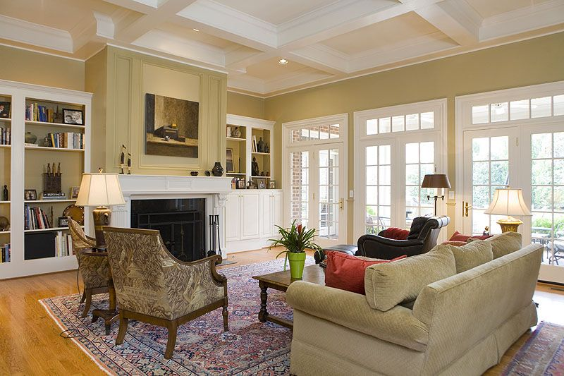 The family room features coffered ceilings and a wall of doors ...