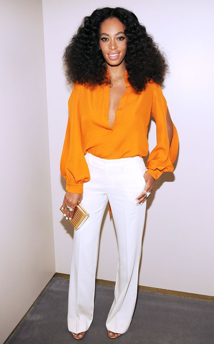 vivid orange blouse and cream white -colored wide-leg pants