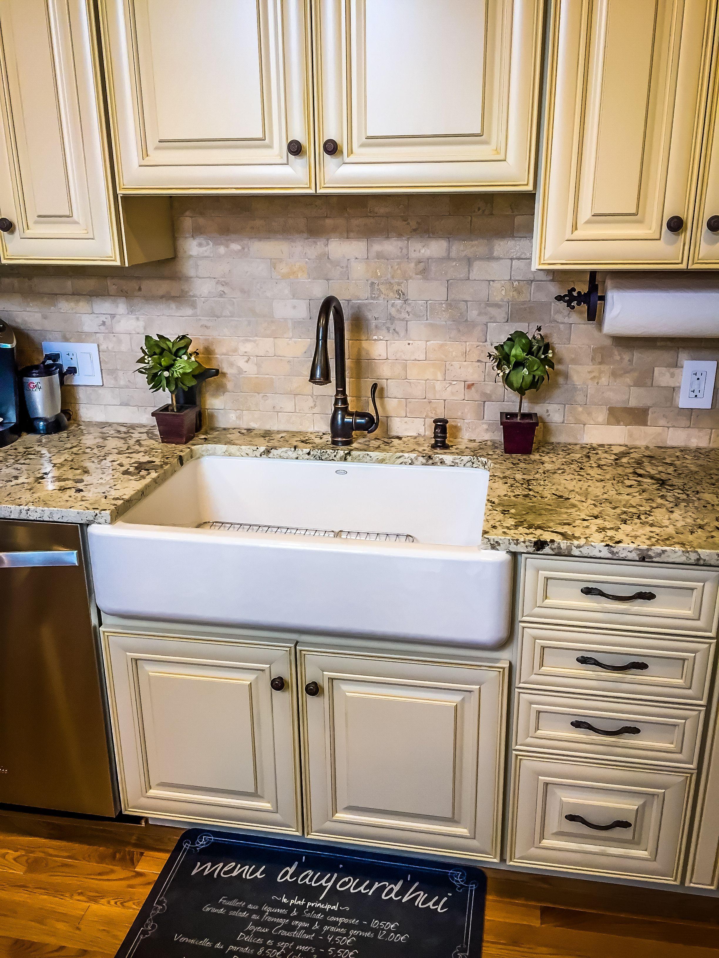 French kitchen farmhouse sink cream cabinets mini chandelier cream granite center island - Kitchen sink in french ...