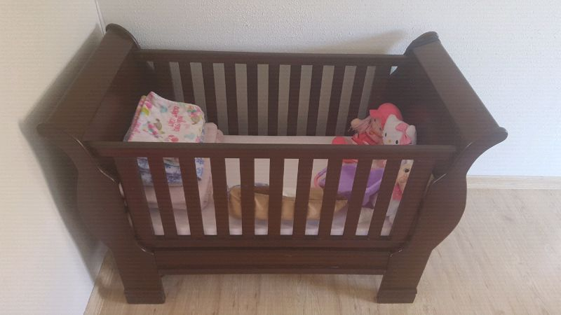 Sleigh mahogany cot for sale. In good condition cars