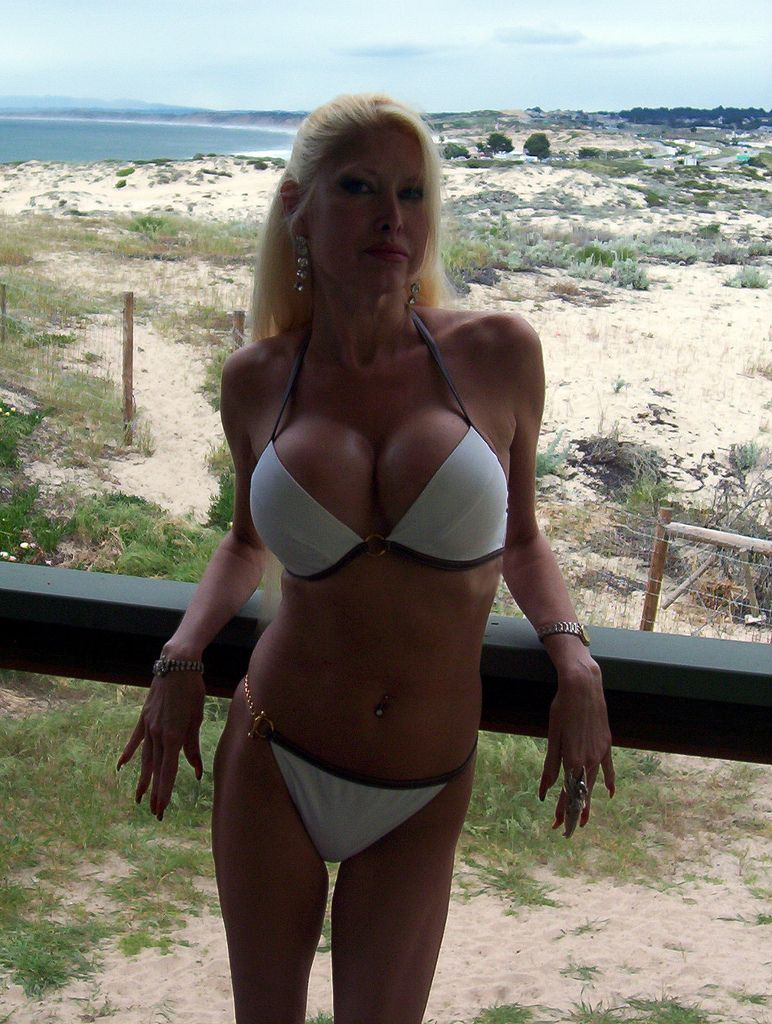 mature milf in bikini showing off bfts | bikinis and swimwear