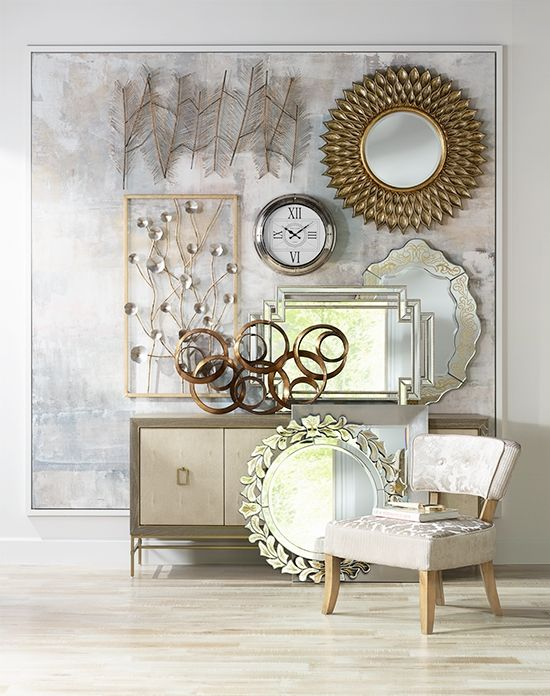 Gallery wall featuring decorative mirrors and metal wall art | Lamps ...