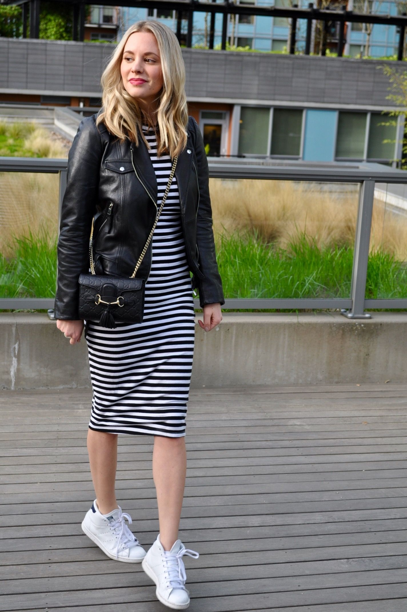 Striped midi dress and leather jacket and sneakers outfit. (Via Confessions  of a Product Junkie blog.) c295c5faa