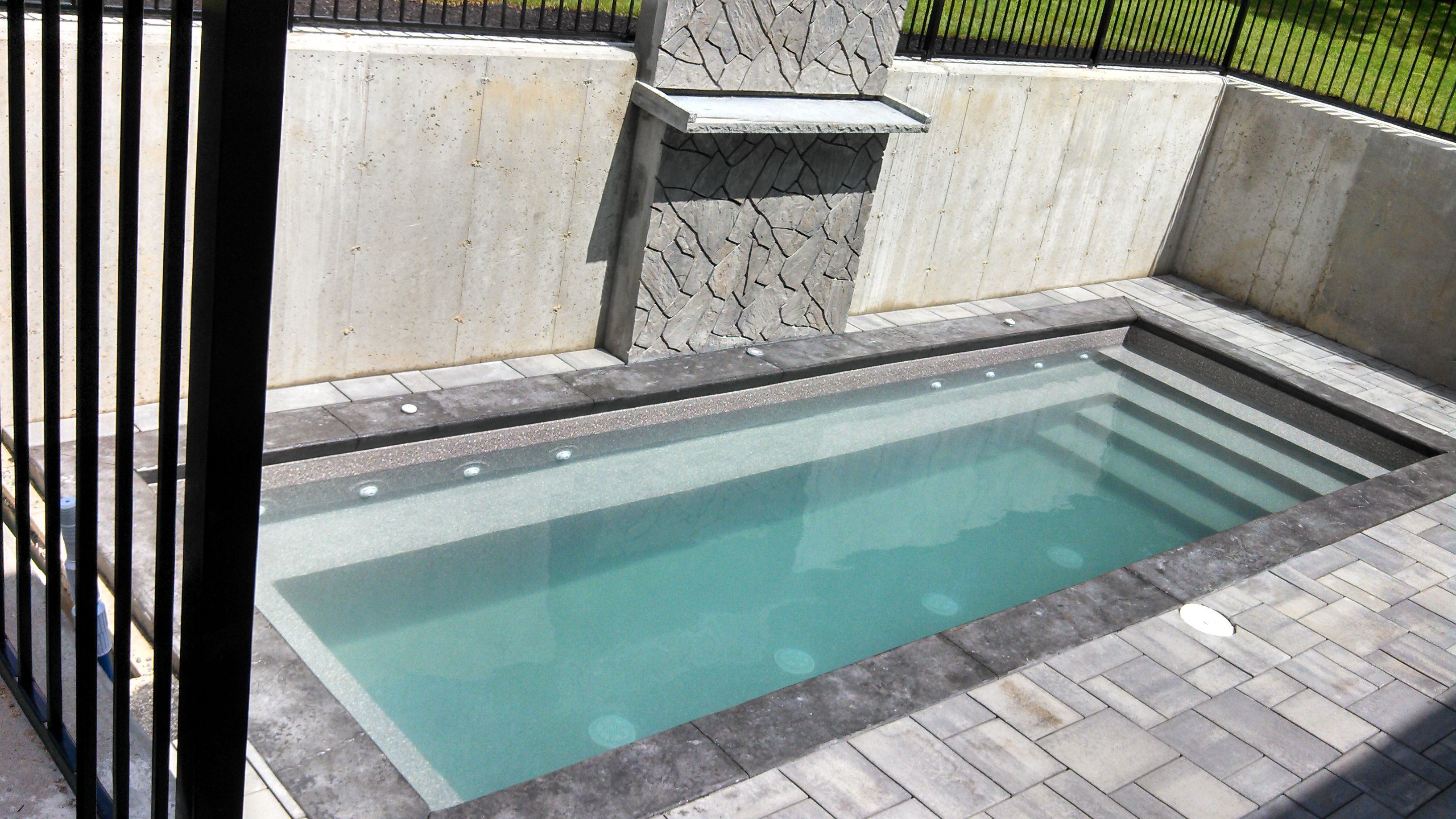 8\'x24\' Radiant inground pool with waterfall, installed below ...