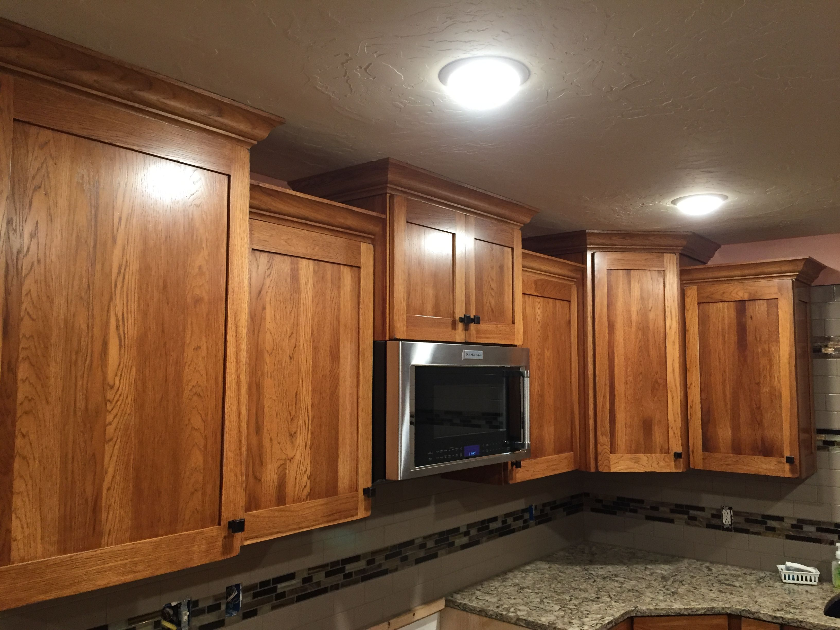 Pecan Cabinets With Crown Molding And Quartz Countertops Kitchen Remodel Kitchen Design Kitchen
